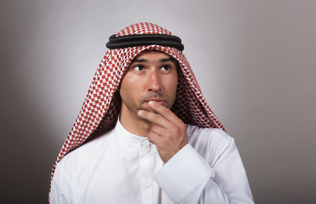 pondering: Studio portrait of a thoughtful arabian man Stock Photo