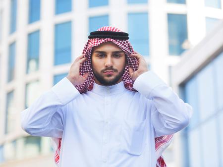 thobe: Outdoors portrait of a handsome arabian man