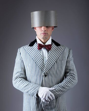 imperturbable: Retro man with a gift box on his head Stock Photo