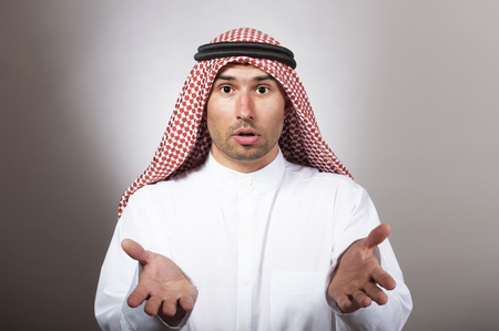 Studio portrait of a bewildered arabian man