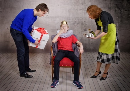 Parents try hard to please their son. Parenting style concept