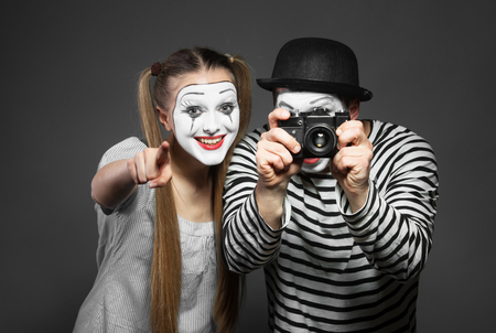 Funny couple of mimes taking a photo Stock Photo