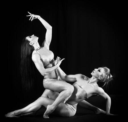 Duet of flexible female dancers