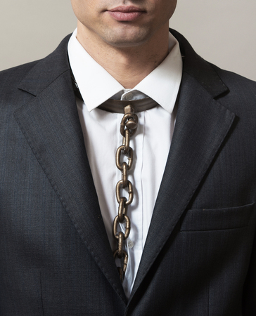 Businessman with chain tie Stock Photo