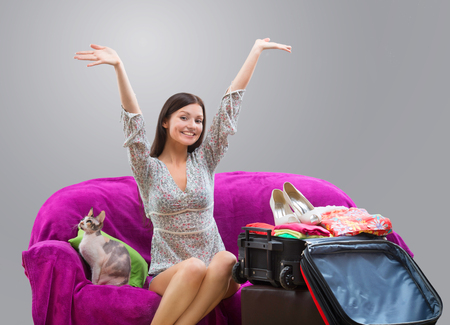 Happy girl going on vacation Stock Photo