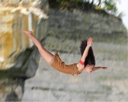 indigene: Girl diving off a cliff Stock Photo