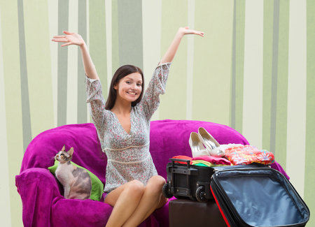 overfilled: Happy girl going on vacation Stock Photo