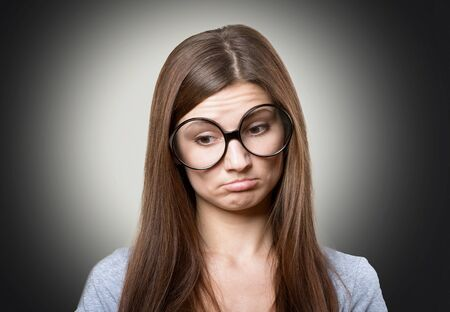 Funny pensive woman in large glasses Stock Photo