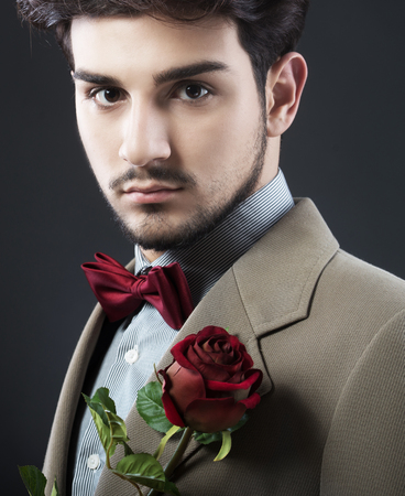 love declaration: Handsome man with a single red rose Stock Photo