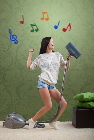 Girl sings while she tidies up the room photo