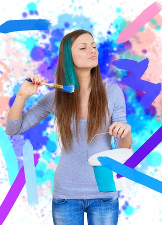 Woman painting the walls and the lock of her hair photo
