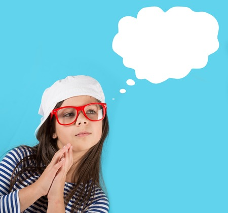 Portrait of a thinking preteen girl with a thought bubble, blue background