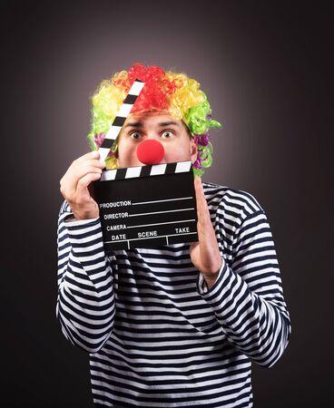 Funny clown with clipper box.