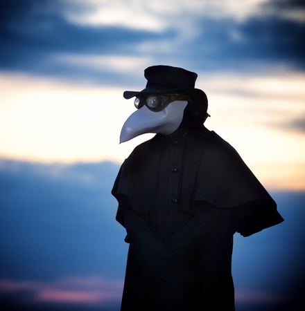 Plague doctor in sunset. Outdoor portrait.