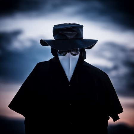 Plague doctor in sunset. Outdoor portrait.