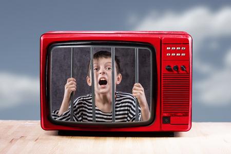 Boy in entertainment prison concept.