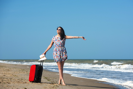 Young beautiful woman during seaside vacation. Stock Photo