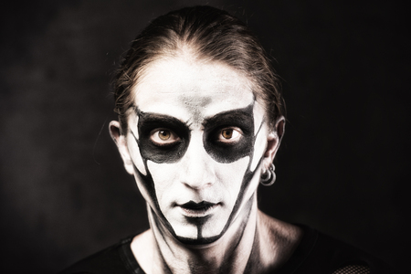 Portrait of man in goth style clothes with skull makeup. Stock Photo