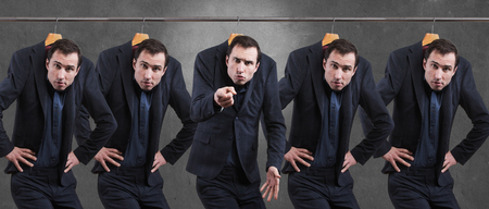 Dissatisfied men in suit hanging in the wardrobe and points to you.