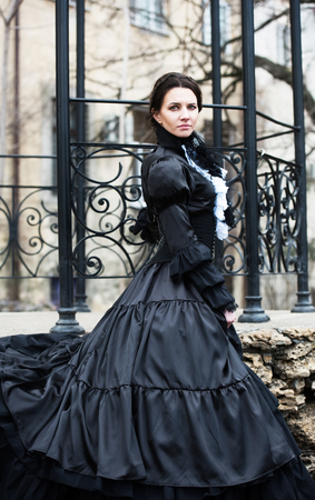 Outdoors portrait of a victorian lady in black Stock Photo