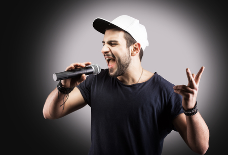 Young man singing into a microphone