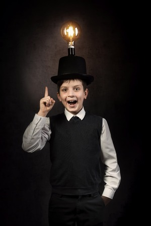 Excellent idea, kid with edison bulb above his head 写真素材