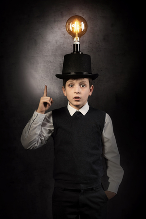 Excellent idea, kid with edison bulb above his head 写真素材 - 121468177