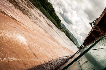 Slow boat advancing between Pakbeng and Luang Prabang Laos
