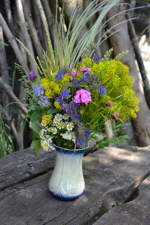 birthday decoration: bouquet of colorful summer flowers in the countryside