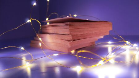 special image with vintage style books decorated with night scene lights