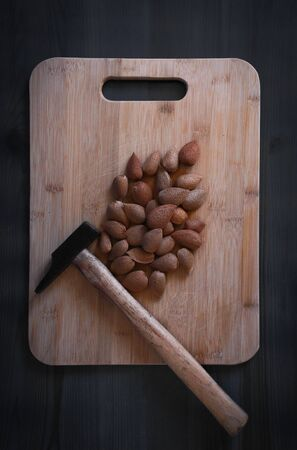 image of a rustic wooden table with very healthy natural almonds ready to eat