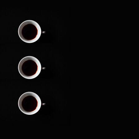 White coffee cups pattern on black background minimal style 版權商用圖片