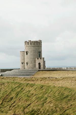 hag: The Cliffs of Moher  Irish  Aillte an Mhothair  are located at the southwestern edge of the Burren region in County Clare, Ireland  They rise 120 metres  390 ft  above the Atlantic Ocean at Hag Editorial