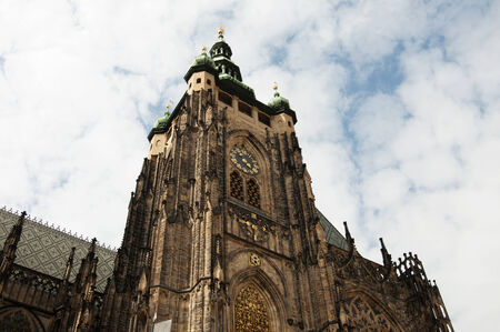 cz: Saint Vitus Cathedral is a Roman Catholic cathedral in Prague, and the seat of the Archbishop of Prague  This cathedral is an excellent example of Gothic architecture and is the biggest and most important church in the country  Located within Prague Castl Stock Photo