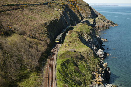 The Cliff Walk is a linear walk between Bray and Greystones, following the train line along the cliffs of Bray Head  Stock Photo