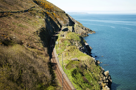 well maintained: The Cliff Walk is a linear walk between Bray and Greystones, following the train line along the cliffs of Bray Head. This well maintained walk offer stunning and dramatic views along steep cliffs into the Irish Sea.  Take one of the many trains to get bac Stock Photo