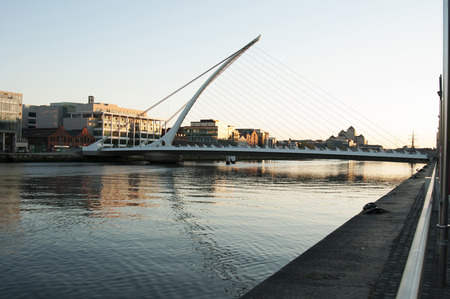 samuel: Samuel Beckett Bridge (Irish: Droichead Samuel Beckett) is a cable-stayed bridge in Dublin that joins Sir John Rogersons Quay on the south side of the River Liffey to Guild Street and North Wall Quay in the Docklands area.