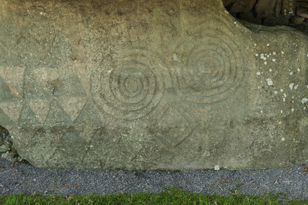 co  meath: It is a Celtic and pre-Celtic symbol found on a number of Irish Megalithic and Neolithic sites, most notably inside the Newgrange passage tomb, on the entrance stone, and on some of the curbstones surrounding the mound. Stock Photo
