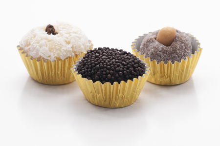 Three Brazilian Sweets - Beijinho, Brigadeiro and Cajuzinho on white background