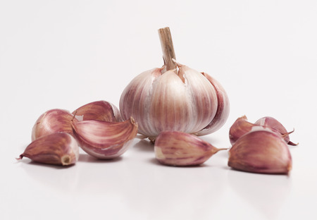 A garlic bulb and a individual cloves isolated on white background Stock Photo