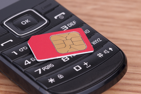 SIM Card over the Phone on the table Stock Photo