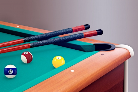 Green billiard table with balls and cues photo
