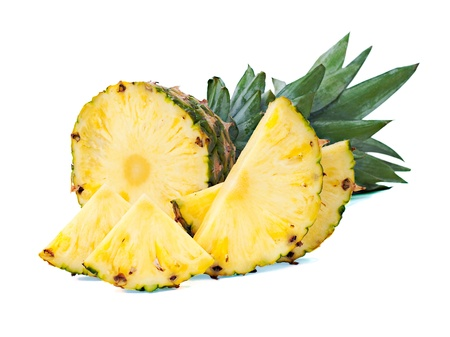 ripe pineapple with slices  isolated on white photo