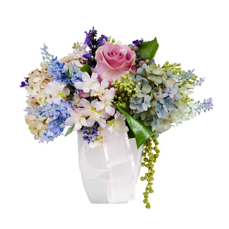 colorful flower bouquet arrangement centerpiece in vase isolated on white photo