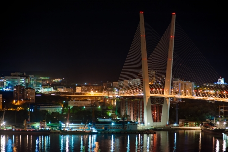 night view of the bridge in the Russian Vladivostok over the Golden Horn bay photo