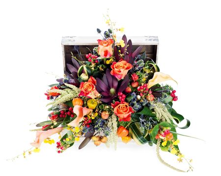 A colorful floral arrangement of roses, lilies, freesia and irises in a wooden chest, isolated on white background Stock Photo - 15797931