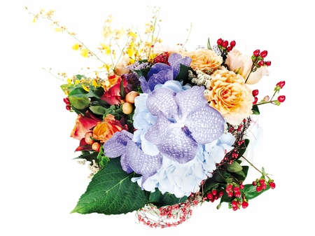 colorful floral arrangement of roses, lilies, freesia, orchids and irises isolated on white background Stock Photo - 15797933