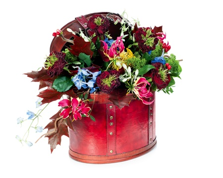 colorful abstract floral arrangement of roses, lilies, irises and maple leaves in red leather bag, isolated on white background Stock Photo - 15797936