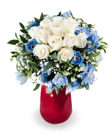 colorful floral bouquet from white roses and delphinium centerpiece in red vase isolated on white background