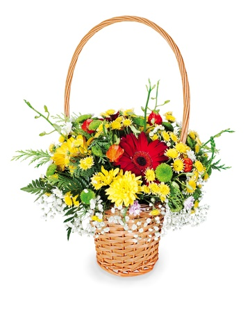 colorful flower bouquet arrangement centerpiece in a wicker gift basket isolated on white background  photo
